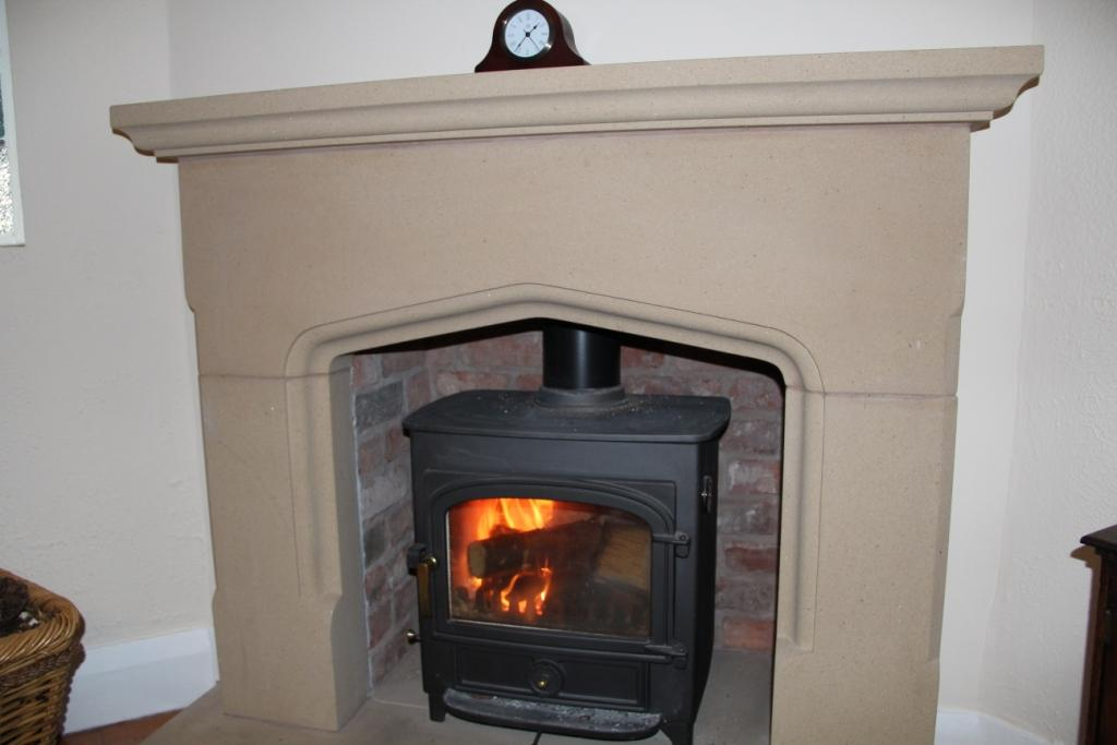 Chester stone fireplace with clearview stove