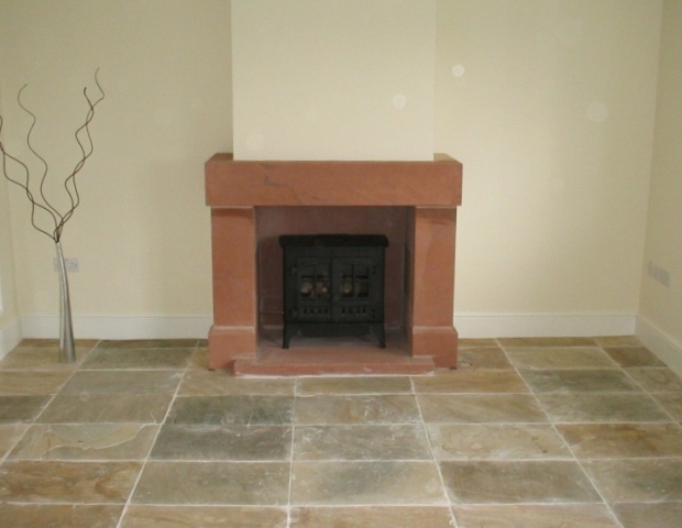 Simple red sandstone fireplace