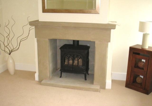Stone chamfered fireplace