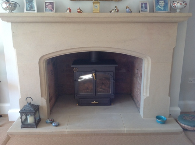Hand made sandstone fire surround with round arch