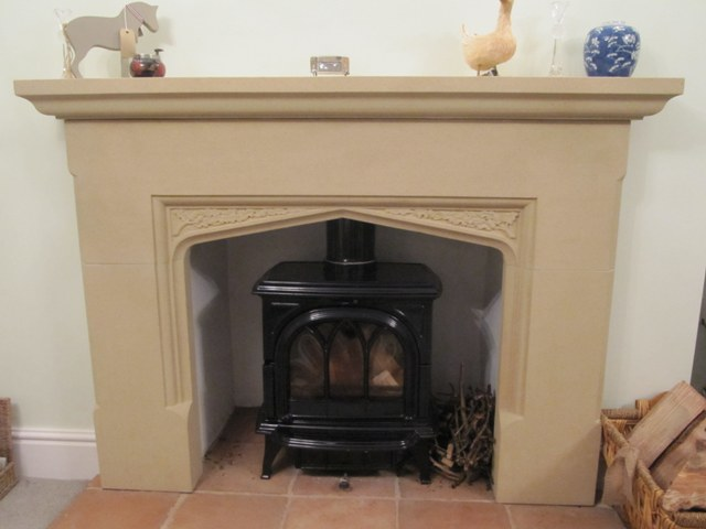 Stone fire surround with hand carved acorns and oak leaves