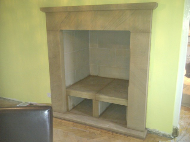 Farm house stone fire surround with log store