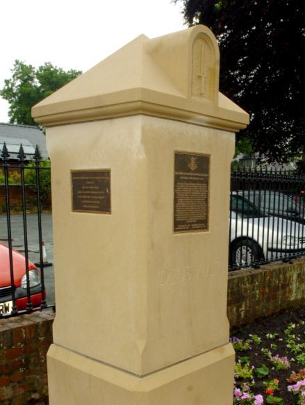 Hand made sandstone war memorial with plaques