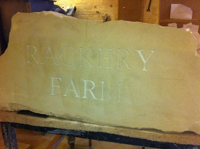 Hand cut letters in sandstone (4)